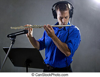 Male Flute Player - male flute player in a recording studio...