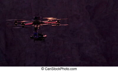 Quadrocopter Backlit Sunset - Powerful quadrocopter curled...