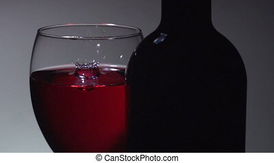 drop in a glass of red wine