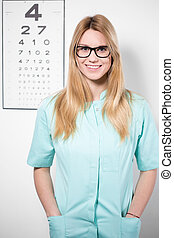 Smiling optician wearing glasses - Image of smiling female...