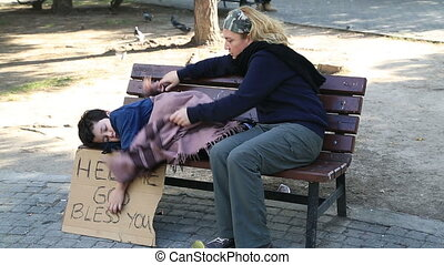 Homeless mother and son - Homeless, sick family begging on a...