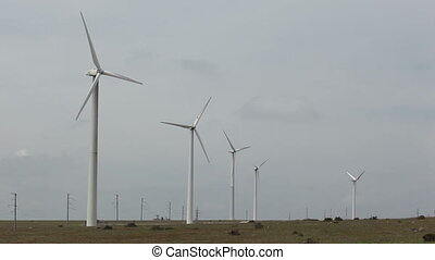 Wind Turbines - Row of wind power generators on blue...