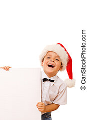 Laughing christmas boy with santa hat and blank sign - Happy...