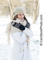 Happy Beautiful Young Woman Winter Saeson in the park...