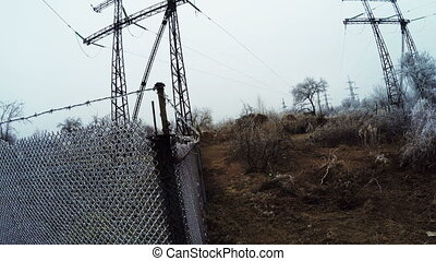 Power transmission lines - Frost on high dry grass and...