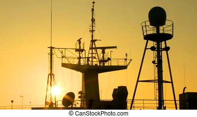 sunrise ship mast - sun at dawn illuminates the ship masts...