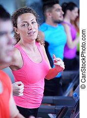 woman exercising on treadmill in gym - sport, fitness,...