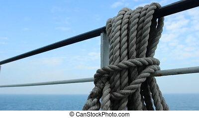 ship rope hanging on the fence