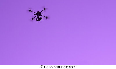 Scout in the Evening Sky - Heavy quadrocopter moves slowly...
