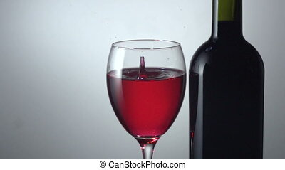 drop in a glass of red wine - Slow motion Red wine being...
