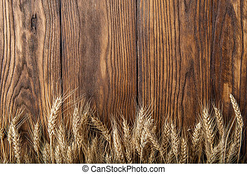 wheat on wooden background top view