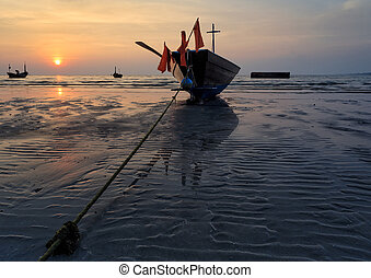 The fishing boat stuck on sand beach , Thailand
