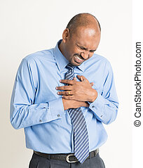 Indian businessman heartache, pressing on chest with painful...