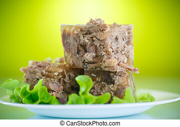 meat aspic - meat in aspic with salad leaves on a green...