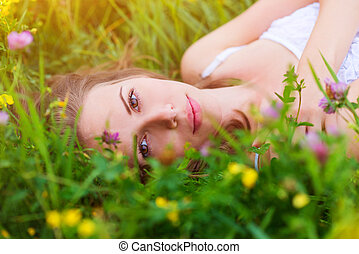 Beautiful woman on a meadow - Attractive young woman with...