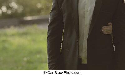 Gentle bride hugs groom aback - Gentle bride huging groom...
