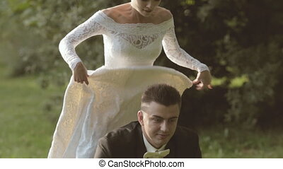 Bride jumping on the back of the groom and laughs