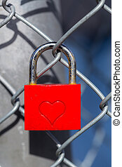 Red heart lock with a fence.