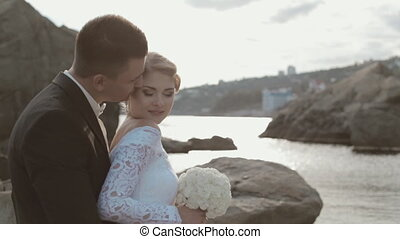 Happy newlyweds near the seaside - Happy newlyweds on the...