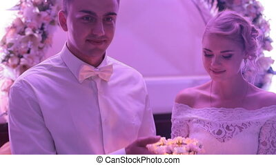 Newlyweds holding a candle at wedding - Newlyweds holding...