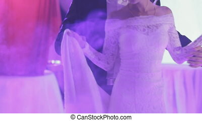 Newlyweds dancing their first wedding dance in a smoke -...