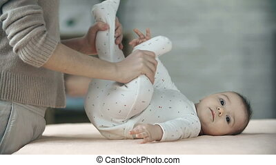 Morning Exercise - Close up of newborn child massaged and...