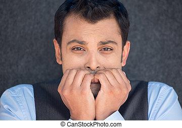 Man biting fingernails - Closeup portrait, young unhappy...