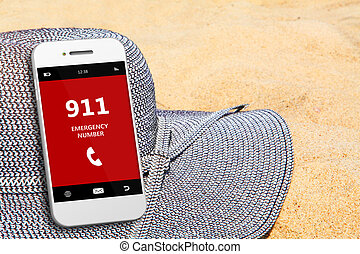 mobile phone with emergency number 911 on the beach focus on...