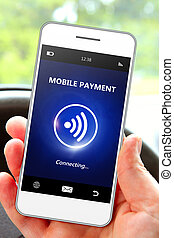 hand holding mobile phone with mobile payment focus on phone...