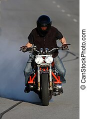 Motorcycle Stunt - Motorbike rider spinning his back wheel...