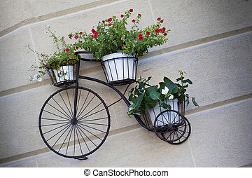 Flowerpots on an old bike on a wall