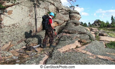 Climber On The Wall - Climber packs the rope