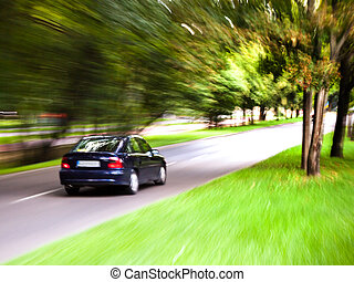 Car moves on road - Car speeding on road with blurred...