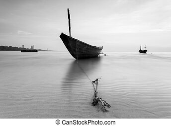 The fishing boat in black and white at Kon Ao Beach, Rayong,...