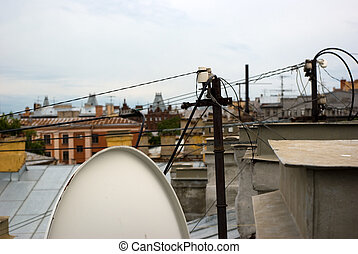 Electrical and television equipment on house roof with...