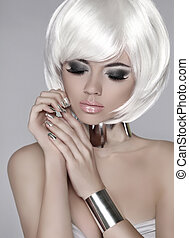 Fashion blond girl. Beautiful face of glamour woman with smoky e