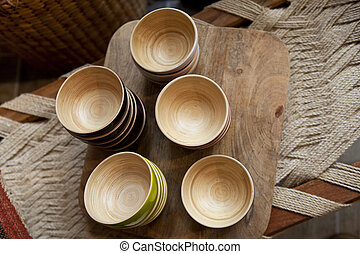 Bamboo bowls on a wooden tray in a kitchen
