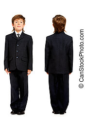 school uniform - Full length portrait of a boy in a suit,...