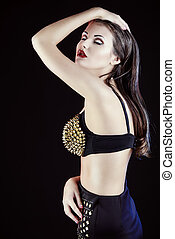 seductress - Fashion shoot of a stunning young woman posing...