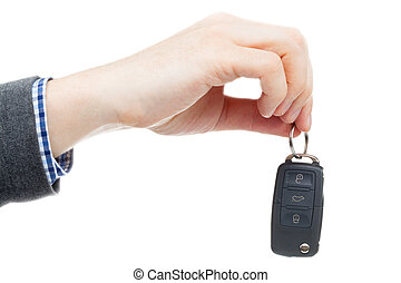 Male hand giving car keys - studio shot over white...