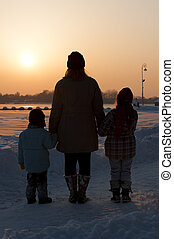 Family at sunset in winter