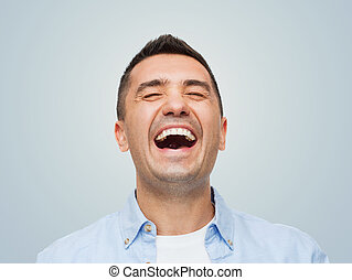 laughing man - happiness, emotions and people concept -...