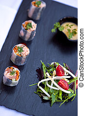 Gastronomic salad - Mixed salad and maki on a slate