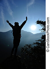woman hiker open arms mountain peak - cheering woman hiker...