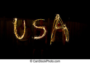 The word USA in sparklers as part of Independance Day July...