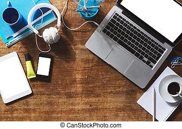Desktop mock up with laptop, digital tablet, smartphone and...