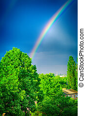 rainbow in dark blue sky