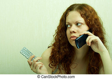 Contraceptives - The girl in confusion holds contraceptive...
