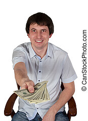 Businessman sitting on a chair holds out dollars - Man in...