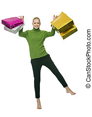 blonde woman with bags - blonde smiling woman with gift bags...